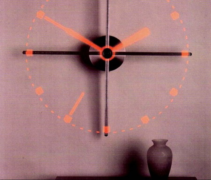 The Virtual Image Clock relies on the human eye's persistence of vision to create the image of a clock face from its 4 rotating arms.
