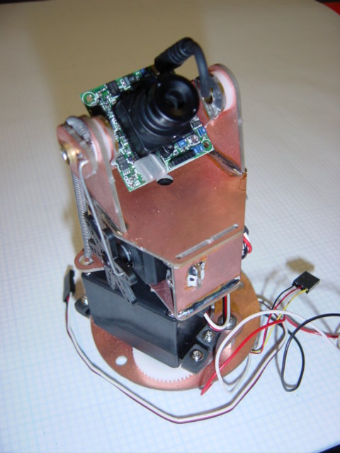 At the time, cheap robotic Pan/Tilt cameras weren't available; so we designed our own, made-from-printed circuit board material.