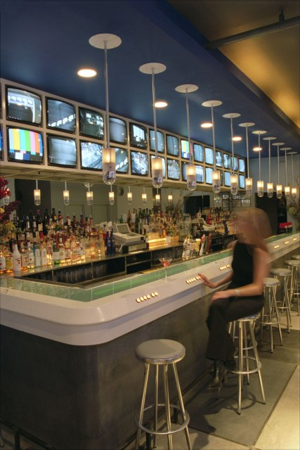 The bar itself featured lamps that contain pan-tilt cameras, buttons to control them, and an LED text ticker embedded in the bar surface.