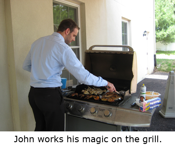 john works his magic on the grill
