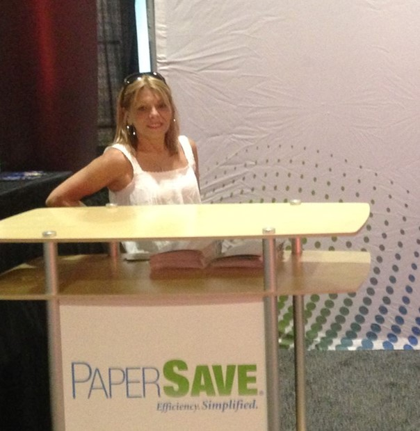 Lu Ann getting the booth ready for the GPUG conference.